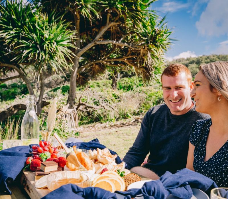 Couple enjoying picnic, South West Rocks, Macleay Valley Coast